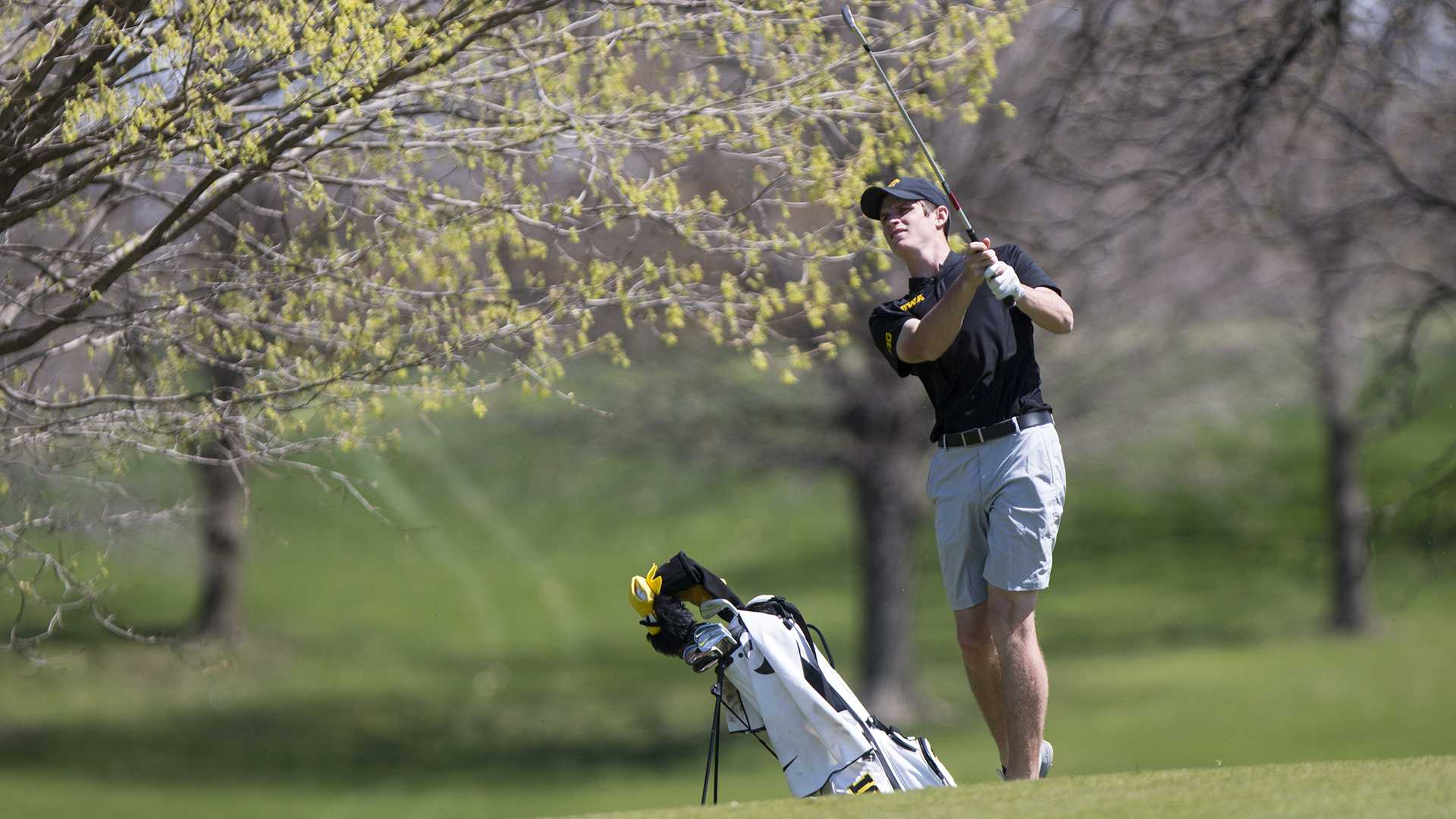 Iowa's Sam Meuret follows through a swing during the Hawkeye Invitational at Finkbine Golf Course on Sunday, April 16, 2017. The Hawkeyes finished second, behind Texas Tech, in the tournament after three rounds scoring 859 (-5; 289, 285, 285). (The Daily Iowan/Joseph Cress)