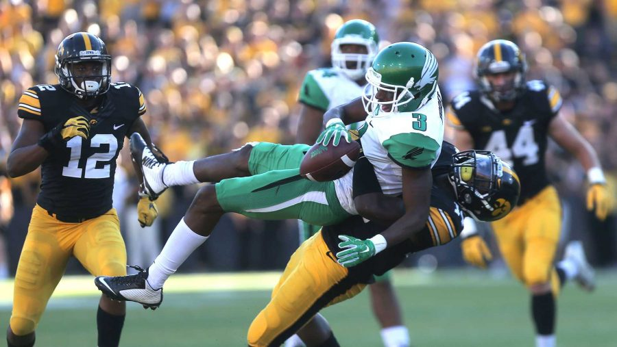 Iowa+defensive+back+Desmond+King+throws+North+Texas+wide+receiver+Tee+Goree+down+to+the+ground+during+the+Iowa-North+Texas+game+in+Kinnick+Stadium+on+Saturday%2C+Sept.+26%2C+2015.+The+Hawkeyes+defeated+the+Mean+Green%2C+62-16.+%28The+Daily+Iowan%2FMargaret+Kispert%29