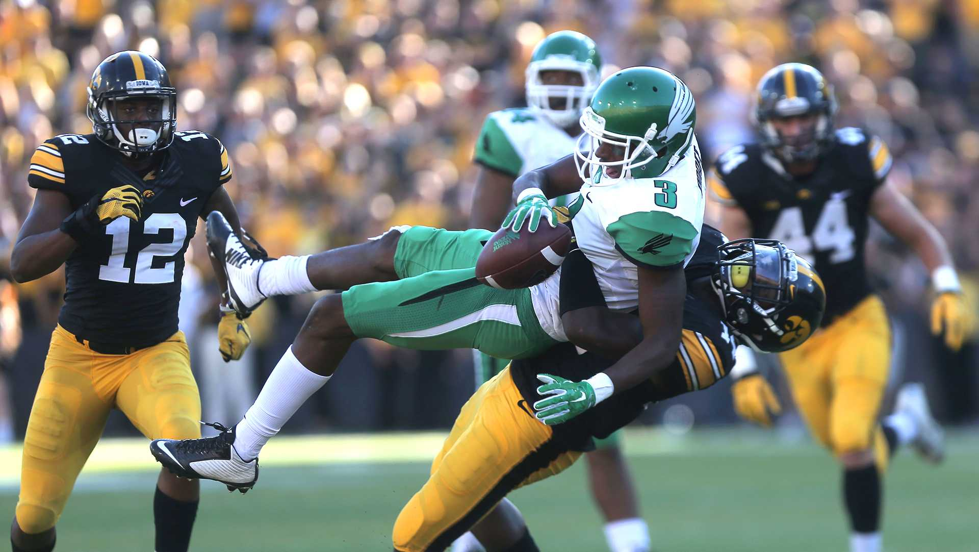 Iowa defensive back Desmond King throws North Texas wide receiver Tee Goree down to the ground during the Iowa-North Texas game in Kinnick Stadium on Saturday, Sept. 26, 2015. The Hawkeyes defeated the Mean Green, 62-16. (The Daily Iowan/Margaret Kispert)