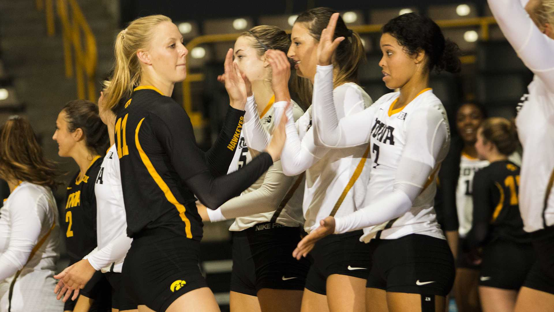 Iowa's Kelsey O'Neill high-fives teammates while going through introductions during the volleyball Black & Gold scrimmage in Carver-Hawkeye Arena on Saturday, Aug. 19, 2017. (Joseph Cress/The Daily Iowan)