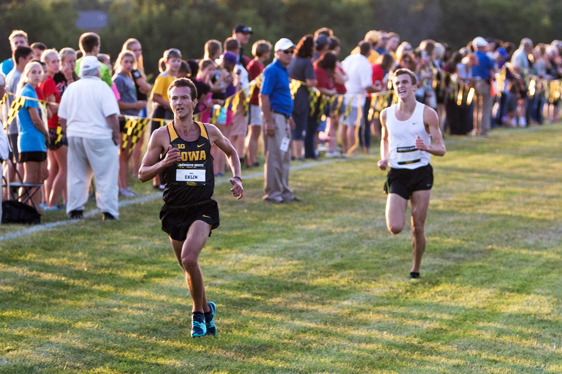 Ian Eklin kicks down a competitor at the finish line at the Hawkeye Invitational Cross Country meet on Friday, September 1, 2017. (David Harmantas/The Daily Iowan)