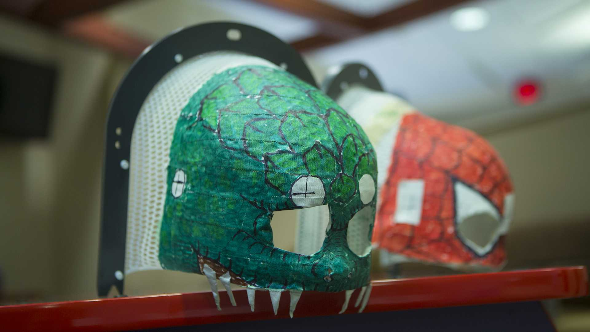 Painted radiation masks are shown in the Pomerantz Pavilian Radiation Oncology Center on Wednesday, Sep. 6, 2017. (Lily Smith/The Daily Iowan)