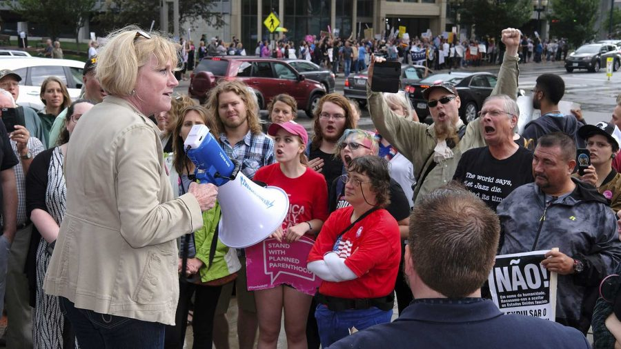 Democratic+candidate+for+governor+Cathy+Glasson+addresses+protestors+outside+of+a+Donald+Trump+rally+in+Cedar+Rapids+on+Wednesday+June+21%2C+2017.+Glasson+is+president+of+SEIU+local+199%2C+a+union+chapter+representing+healthcare+workers+and+school+support+employees.+%28The+Daily+Iowan%2FNick+Rohlman%29
