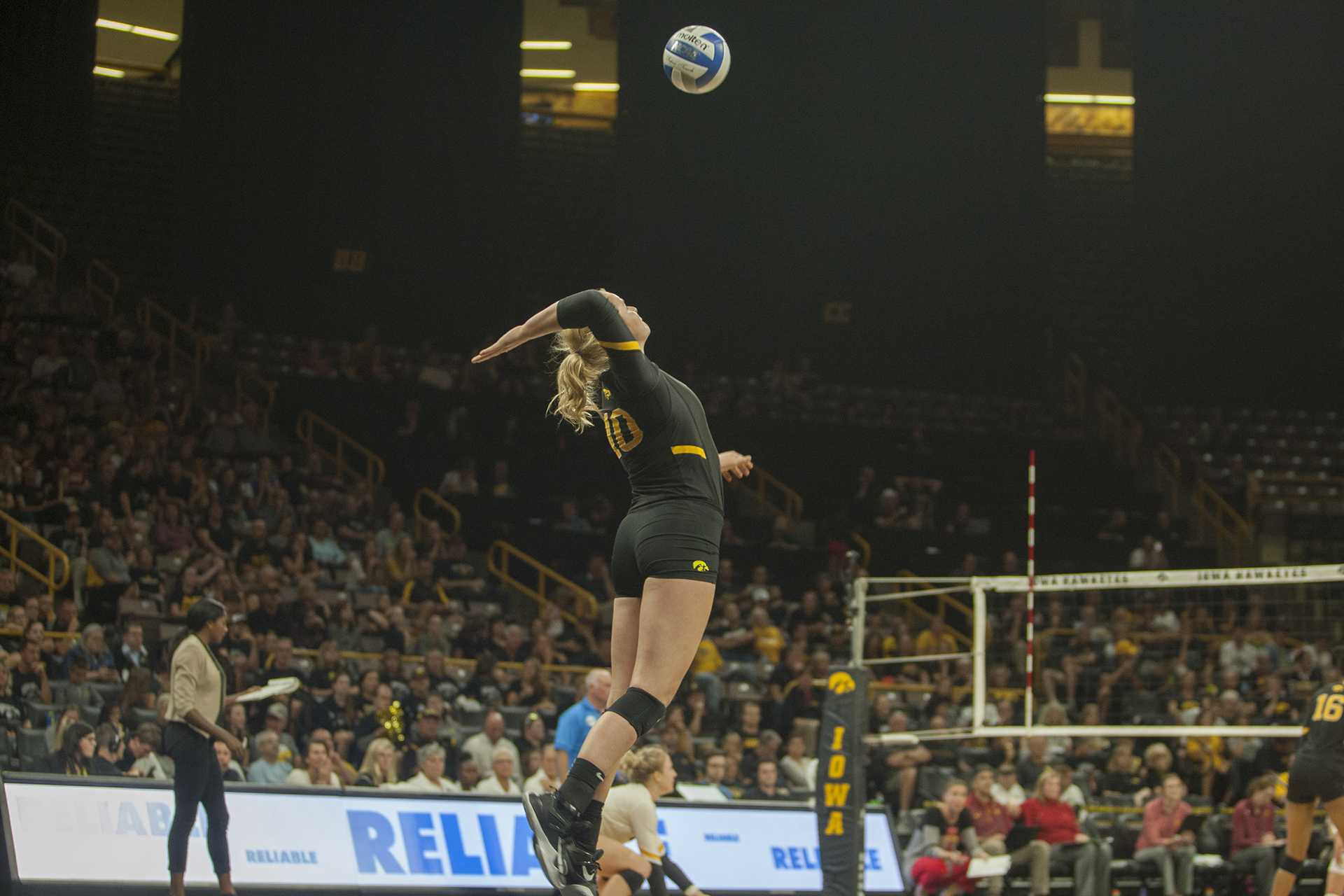 Iowa OH Claire Sheehan serves the ball during the match between Iowa and Iowa State inside Carver-Hawkeye Arena on Friday, September 8, 2017. The Hawkeyes fell to the Cyclones 3-1. (Shivansh Ahuja/The Daily Iowan)