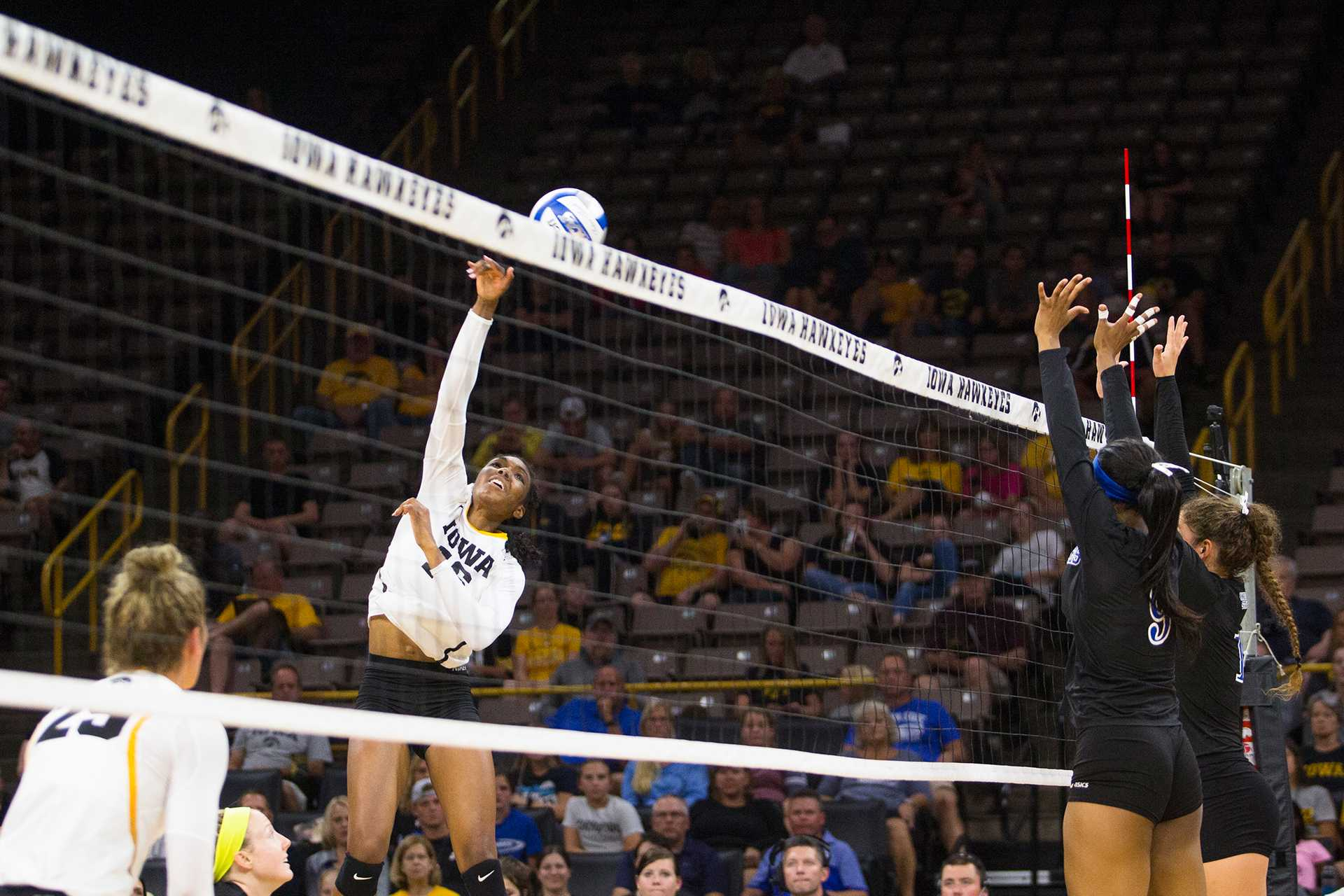 Iowa outside hitter Taylor Louis spikes a ball over the net during an NCAA volleyball game between Iowa and Indiana State on Saturday, Sept. 2, 2017. The Hawkeyes defeated the Sycamores, 3-1. (Joseph Cress/The Daily Iowan)