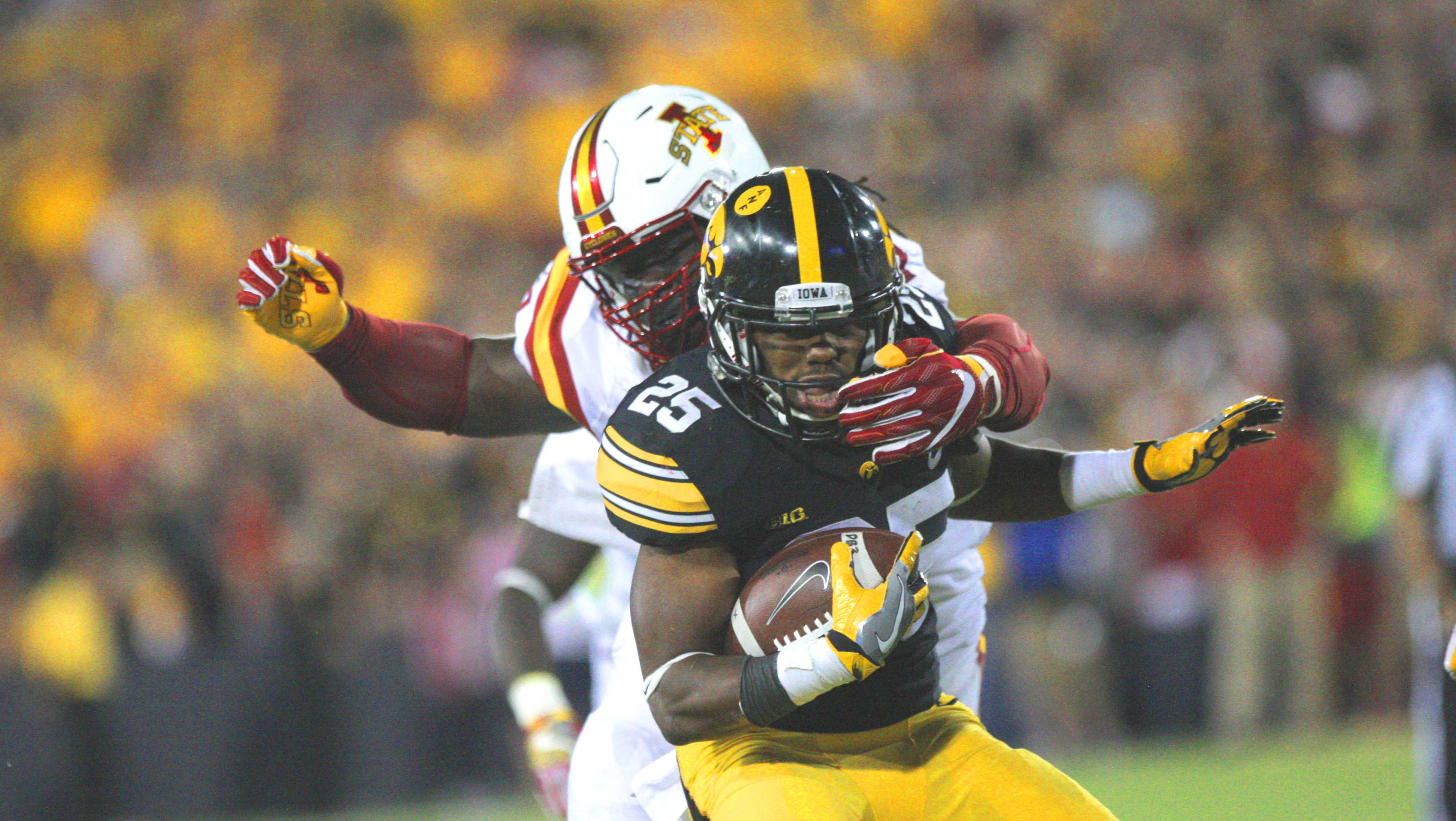 Iowa running back Akrum Wadley gets tackled during the Iowa Corn Cy-Hawk trophy game between Iowa and Iowa State in Kinnick Stadium on Sept. 10, 2016. The Hawkeyes handily defeated the Cyclones, 42-3. (The Daily Iowan/File Photo)