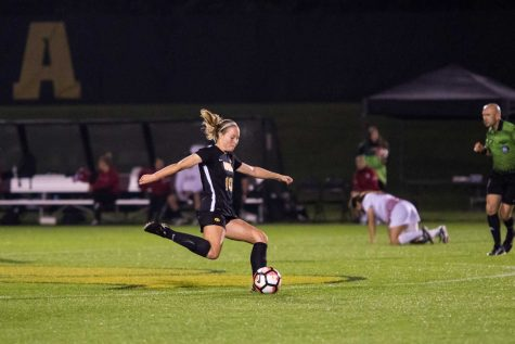 Iowa's Natalie Winters kicks the ball during the Iowa/Rutgers soccer game on Thursday, Oct. 5, 2017. Iowa won the match 1-0.