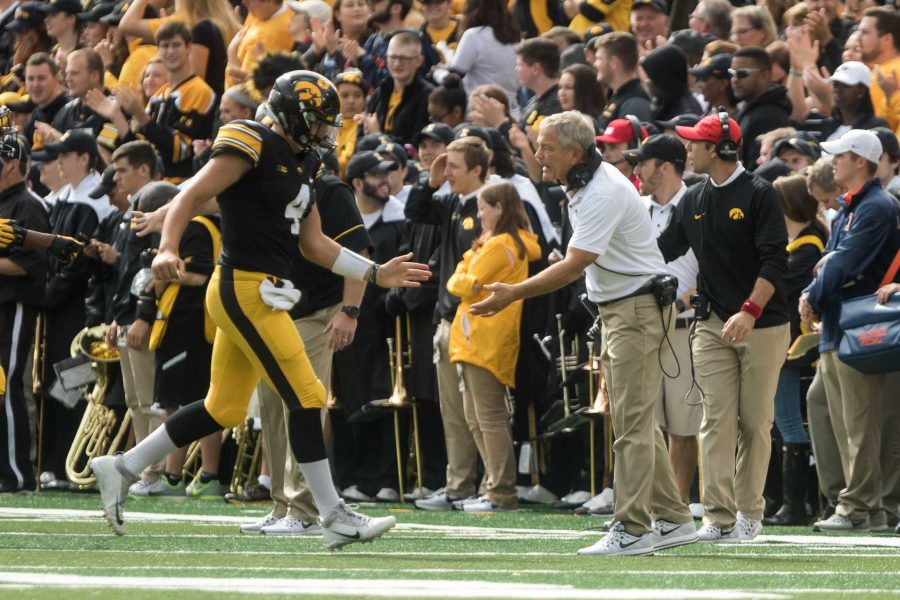 Iowa+head+coach+Kirk+Ferentz+congratulates+quaterback+Nate+Stanley+during+the+Iowa%2FIllinois+football+game+on+Saturday%2C+7+Oct.+2017.+Iowa+won+the+game+45-16.+%28David+Harmantas%2FThe+Daily+Iowan%29