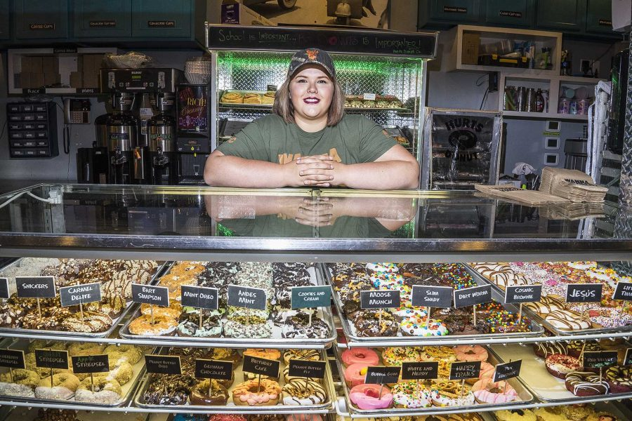 University of Iowa student, Courtney Otradovec, poses for a portrait while working at Hertz Donut on Wednesday, Oct. 11, 2017. The company is doing a clown based delivery service throughout the month of october upon request. (James Year/The Daily Iowan)