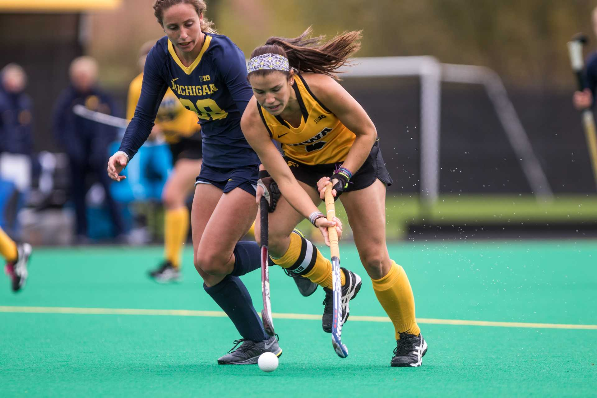 Iowa field hockey player Mallory Lefkowitz fights for the ball during a match against the Michigan Wolverines on Sunday, Oct. 15, 2017.  The Wolverines defeated the Hawkeyes 3-2.