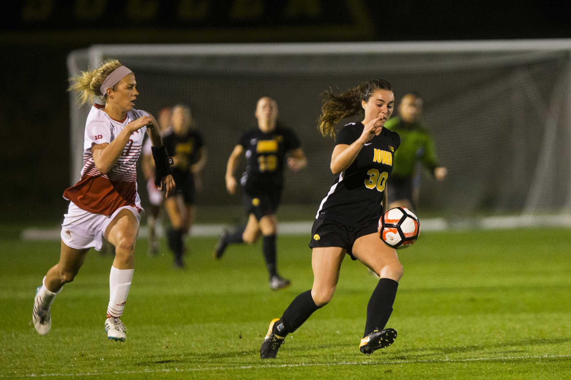 Iowa forward Devin Burns runs a ball down during the Iowa/Nebraska women's soccer game at the UI Soccer Complex on Wednesday, Oct. 18, 2017. The Hawkeyes ended their game against the Cornhuskers in a 0-0 tie after two overtime periods. (Joseph Cress/The Daily Iowan)