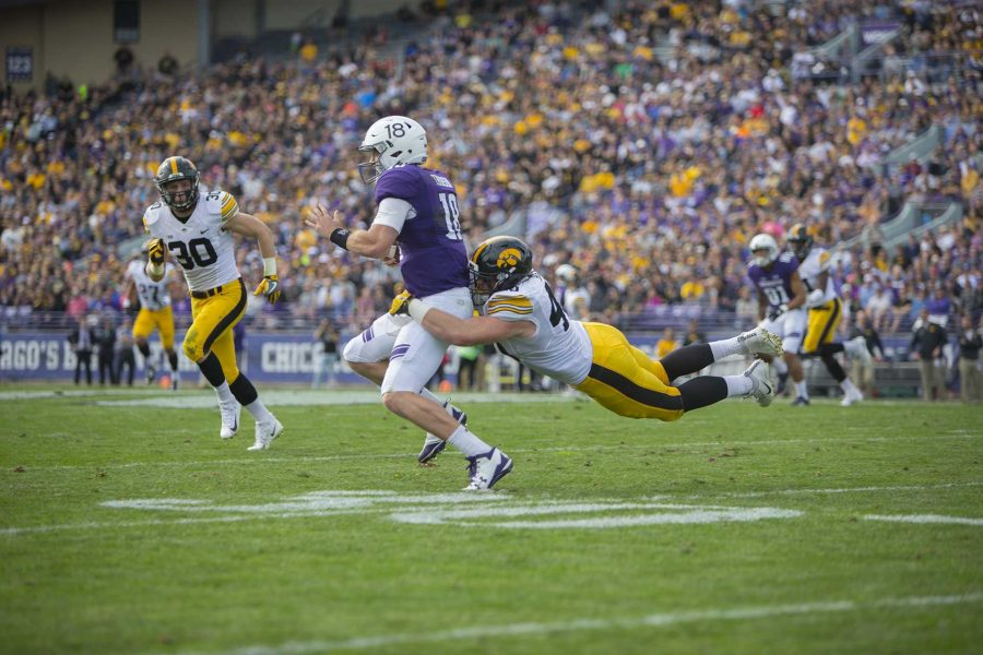 Iowa+defensive+end+Parker+Hesse+tackles+Northwestern+quarterback+Clayton+Thorson+during+the+game+between+Iowa+and+Northwestern+at+Ryan+Field+in+Evanston+on+Saturday%2C+Oct.+21%2C+2017.+The+wildcats+defeated+the+Hawkeyes%2C+17-10%2C+in+overtime.+%28Lily+Smith%2FThe+Daily+Iowan%29