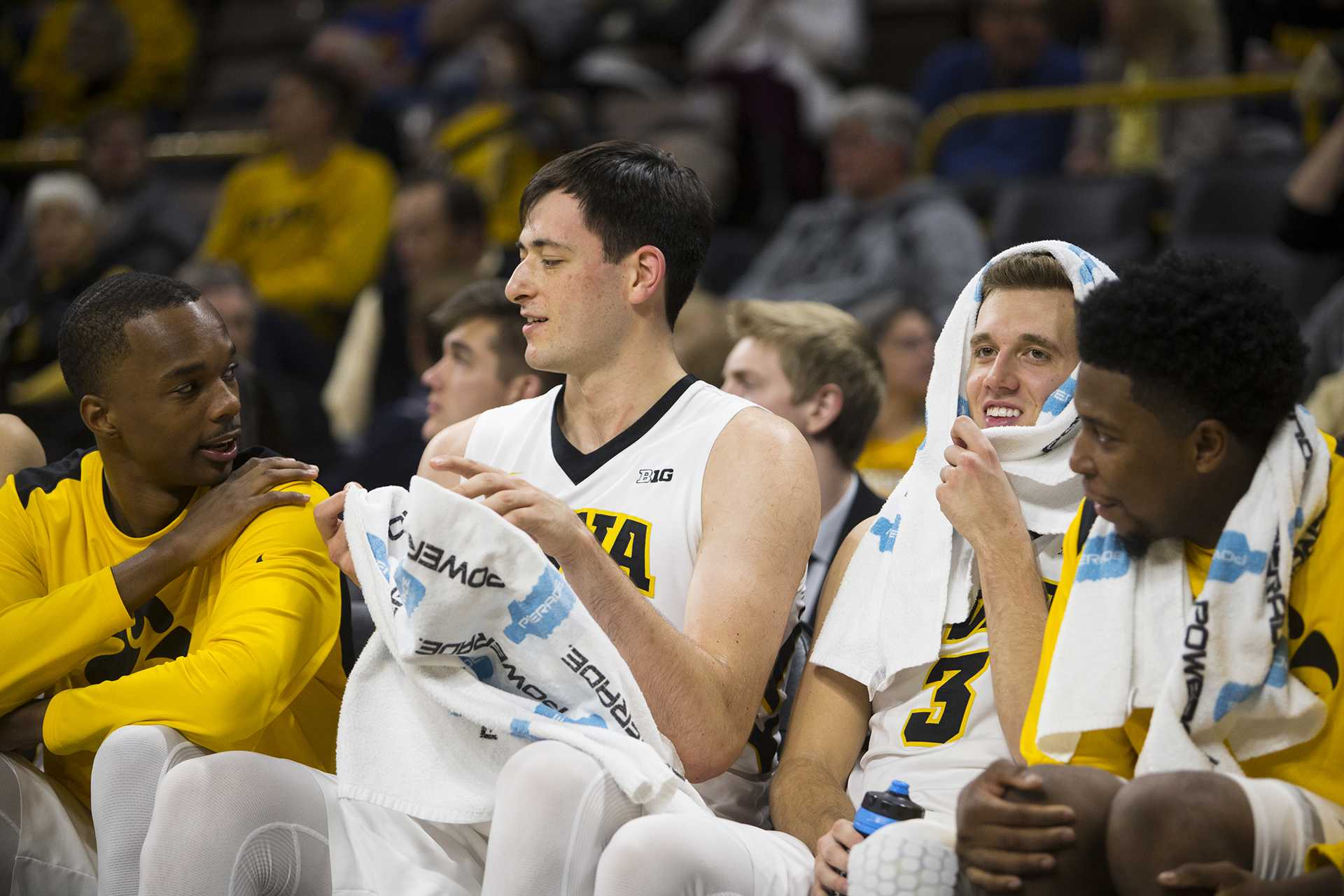 Iowa's Maishe Dailey, Ryan Kriener, Jordan Bohannon, and Isaiah Moss chat on the bench during a men's basketball exhibition game between Iowan and William Jewell College in Carver-Hawkeye Arena on Friday, Oct. 27, 2017. The Hawkeyes defeated the Cardinals, 105-81. (Joseph Cress/The Daily Iowan)
