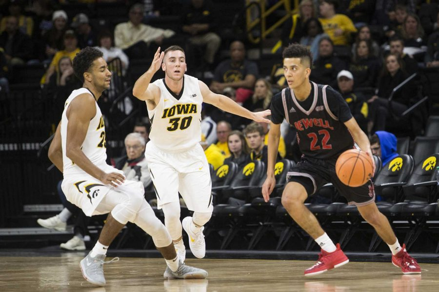 Iowa forward Dom Uhl and guard Connor McCaffery cover William Jewell guard Bryon Harp during a mens basketball exhibition game between Iowa and William Jewell College in Carver-Hawkeye Arena on Friday, Oct. 27, 2017. The Hawkeyes defeated the Cardinals, 105-81. (Joseph Cress/The Daily Iowan)