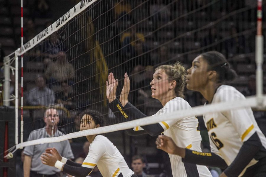 Iowa%27s+Brie+Orr%2C+Jess+Janota%2C+and+Taylor+Louis+prepare+for+the+ball+during+a+match+against+Michigan+at+Carver-Hawkeye+Arena+on+Wednesday%2C+Oct.+4%2C+2017.+Iowa+defeated+Michigan+3+sets+to+1.+%28Nick+Rohlman%2FThe+Daily+Iowan%29