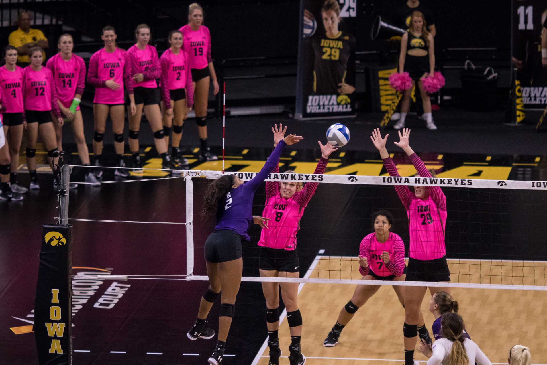 Players battle at the net during the volleyball match between the University of Iowa Hawkeyes and the Northwestern University Wildcats on Saturday, Oct. 21, 2017. The Hawkeyes defeated the Wildcats three sets to zero. (David Harmantas/The Daily Iowan)