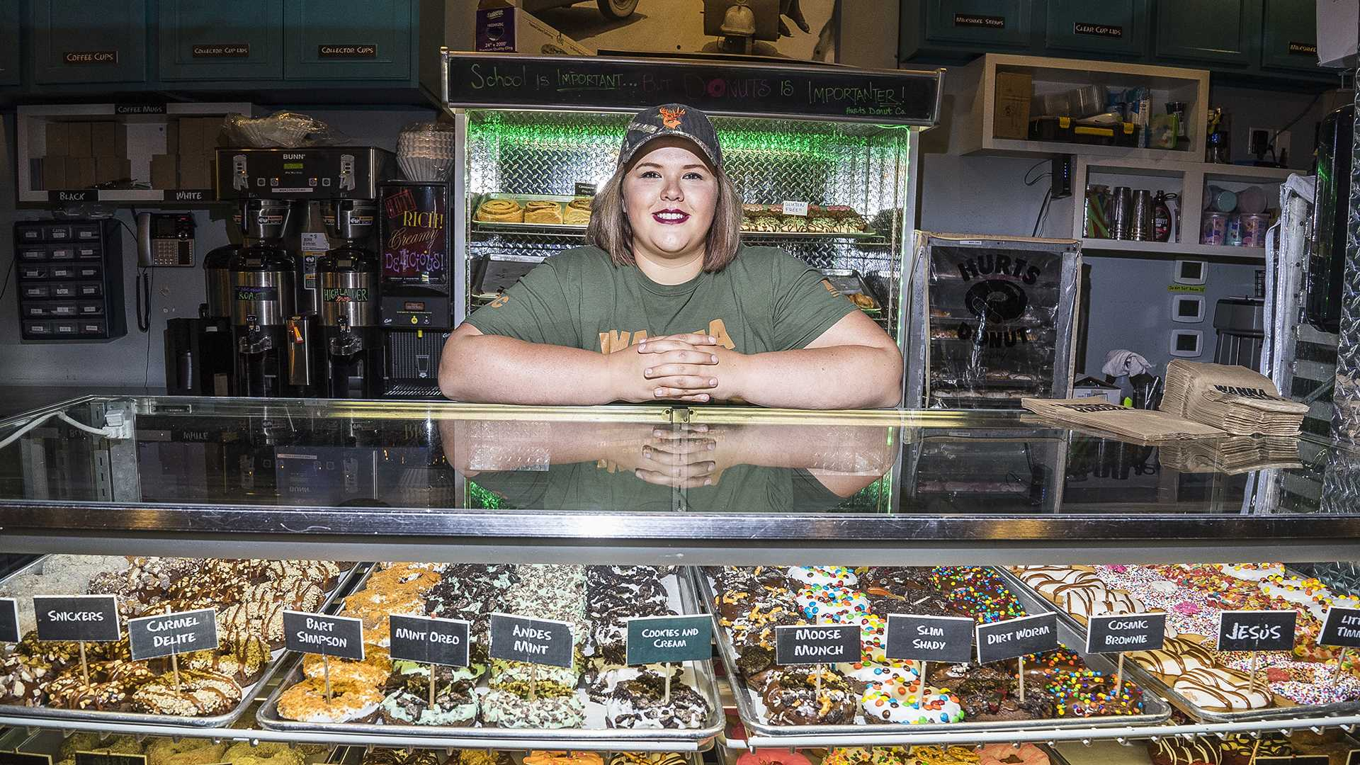 UI student Courtney Otradovec works at Hurts Doughnut on Wednesday, Oct. 11, 2017. The company offers a clown-based delivery service during the month of October. (James Year/The Daily Iowan)