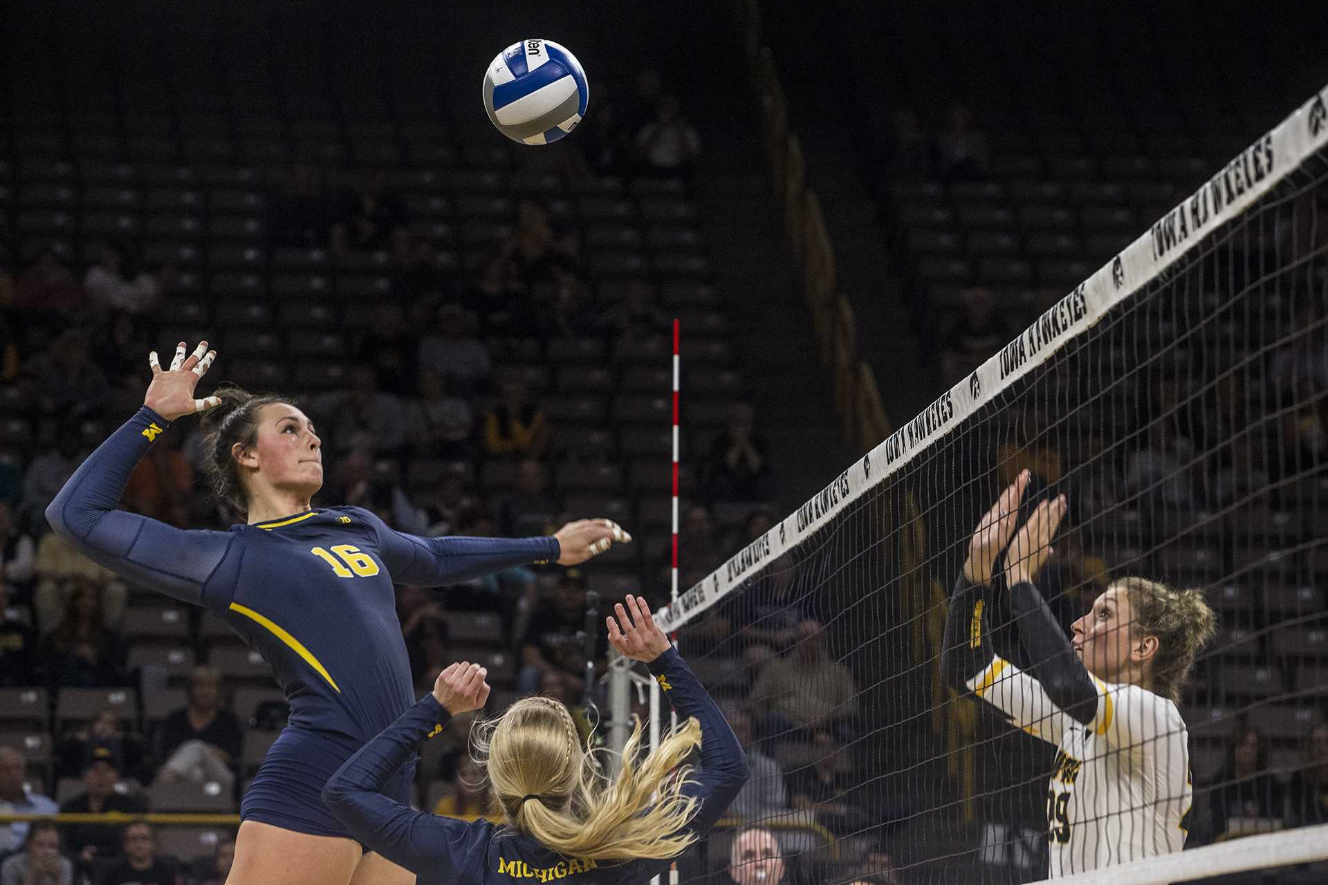 Michigan's Cori Crocker spikes the ball during a match against Iowa at Carver-Hawkeye Arena on Wednesday, Oct. 4, 2017. Iowa defeated Michigan 3 sets to 1. (Nick Rohlman/The Daily Iowan)
