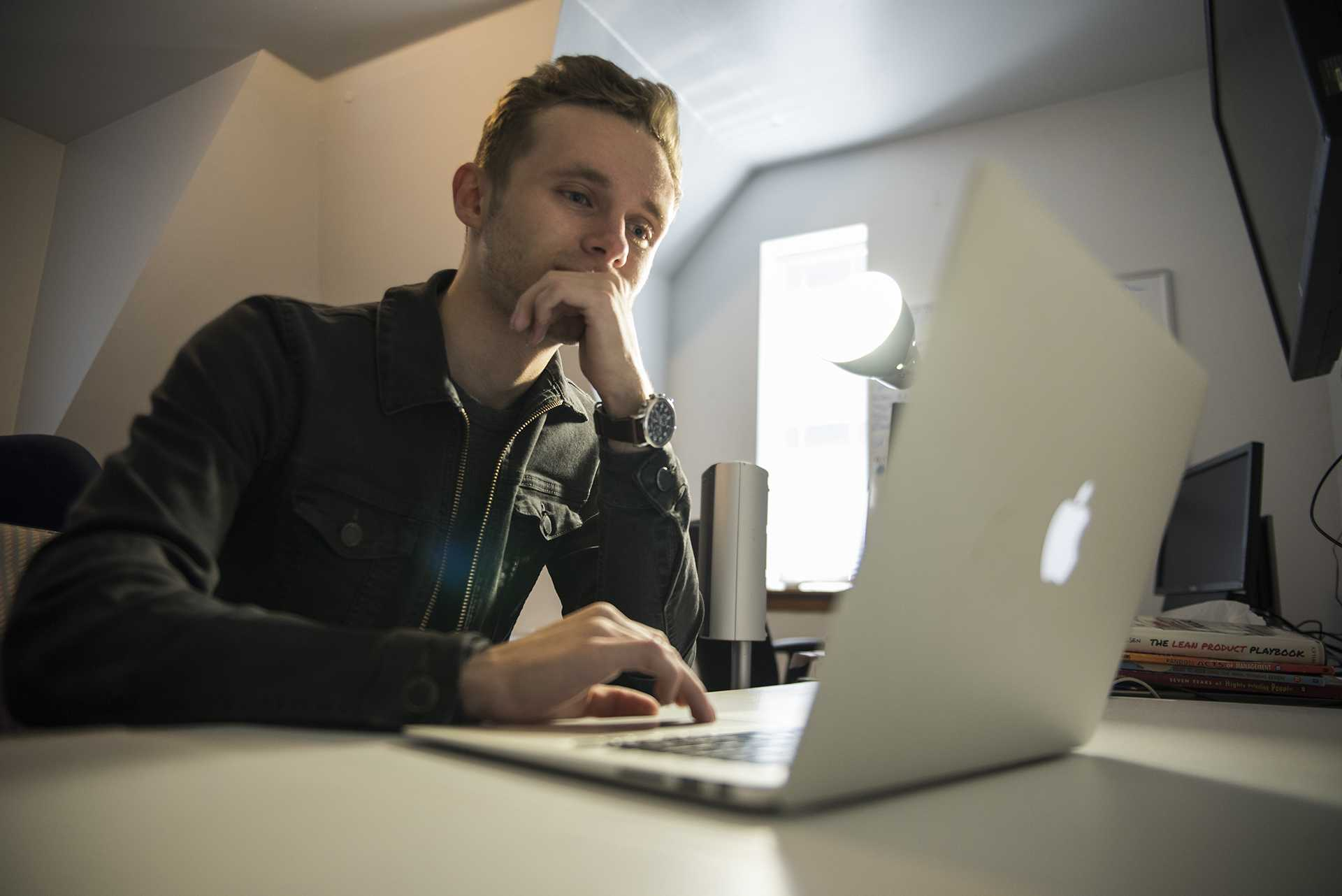 Logan Grote, cofounder of Abal Therapeutics, works inside his office at 322 N. Clinton St. on Monday, Oct. 9. Abal is a startup company developing software to streamline the process of ABA, Applied Behavior Analysis. The tablet-based application aims to improve the success of ABA practice. (Ben Smith/The Daily Iowan)