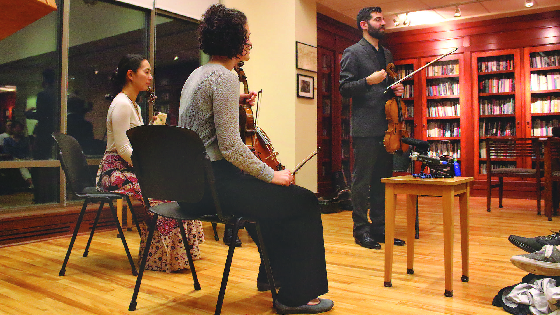 Jonah Sirota introduces the quartet in the Frank Conroy Reading Room of the Dey House on Thursday, Oct. 5, 2017. The Chiara Quartet teamed up with the Iowa Writing Program to create a performance about memory. (Ashley Morris/The Daily Iowan)