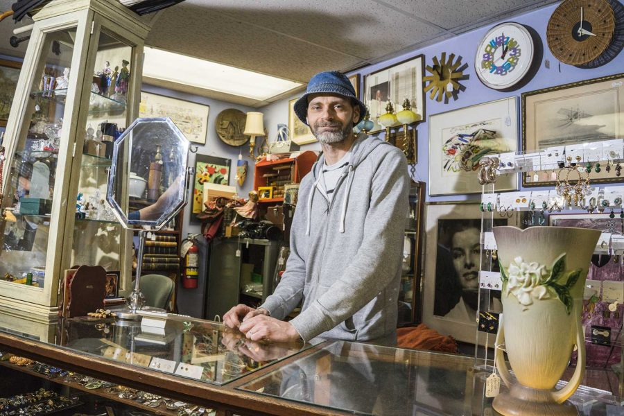 Artifacts employee, Steve Squires, poses for a portrait on Sunday, Oct 8. 2017. Steve has worked here for over 4 years and is kept busy with selling and managing the stores massive inventory of vintage items. (James Year/The Daily Iowan)
