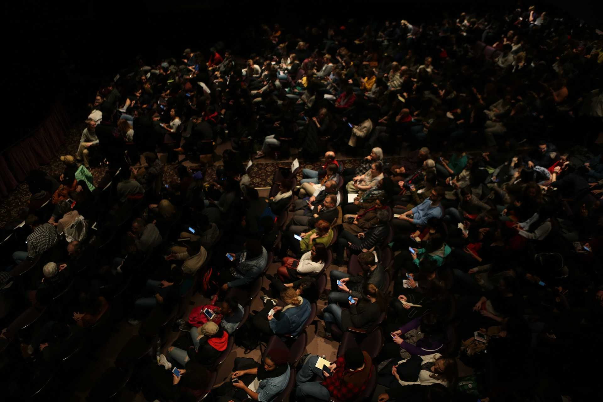 The audience listens to Patrisse Cullors, co-founder of the Black Lives Matter movement at Englert Theatre in Iowa City on Monday. Feb. 6, 2017. Cullors discusses the current state of the country and how citizens can help to make change. (The Daily Iowan/Courtney Hawkins)