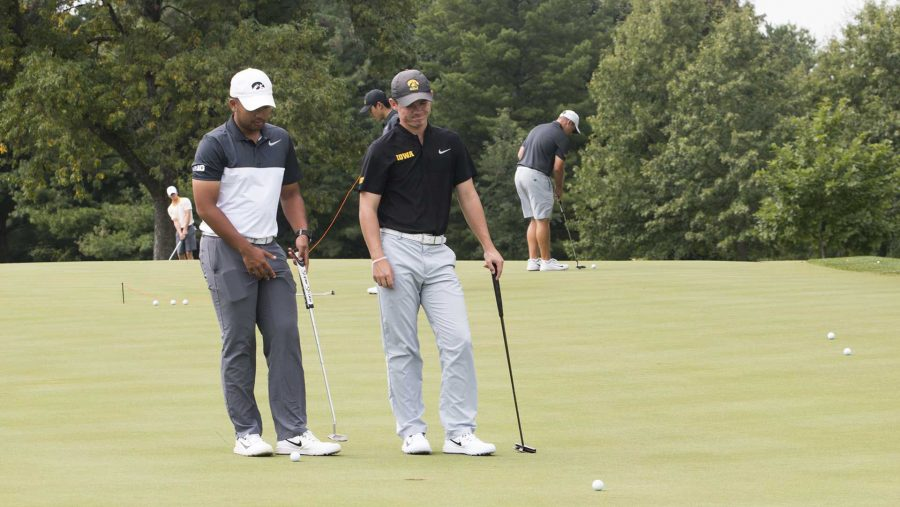 Iowa golfer Ryoto Furuya stands with Alex Moorman during a mens golf practice on Thursday, Aug. 31, 2017. The mens team will travel to Minnesota for the Gopher Invitational on Sept. 10.(Joseph Cress/The Daily Iowan)
