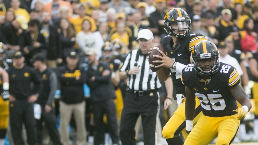 Iowa+quarterback+Nate+Stanley+looks+to+pass+while+getting+a+block+by+Akrum+Wadley+during+an+NCAA+football+game+between+Iowa+and+Illinois+in+Kinnick+Stadium+on+Saturday%2C+Oct.+7%2C+2017.++The+Hawkeyes+defeated+the+Fighting+Illini%2C+45-16.+%28Joseph+Cress%2FThe+Daily+Iowan%29
