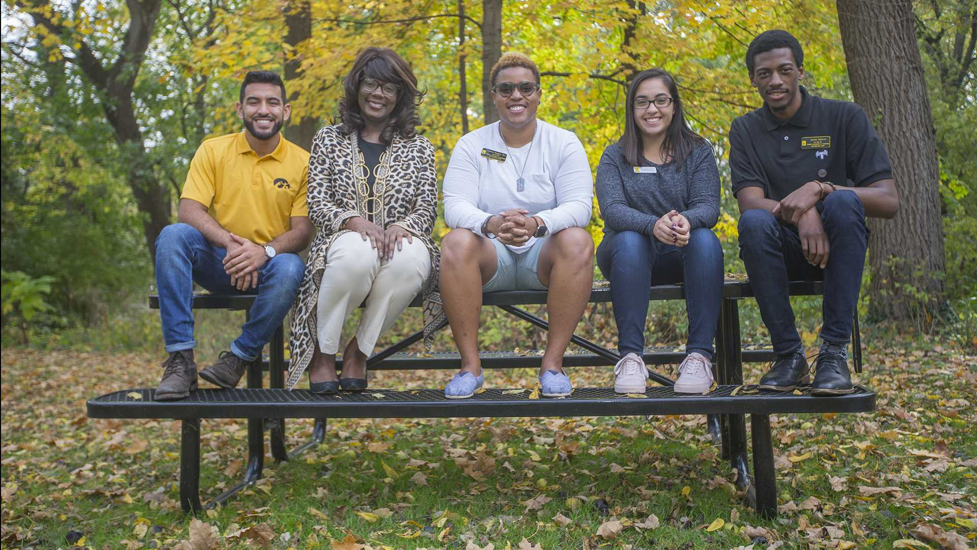 From left: Jesus Payan, VP for Student Life Melissa Shivers, Tab Wiggins, Prisma Ruacho, and Jamal Nelson sit outside the Asian Pacific American Cultural Center during an interview with Shivers and leaders from the UI cultural and resource centers on Friday, Oct. 20, 2017. (Lily Smith/The Daily Iowan)
