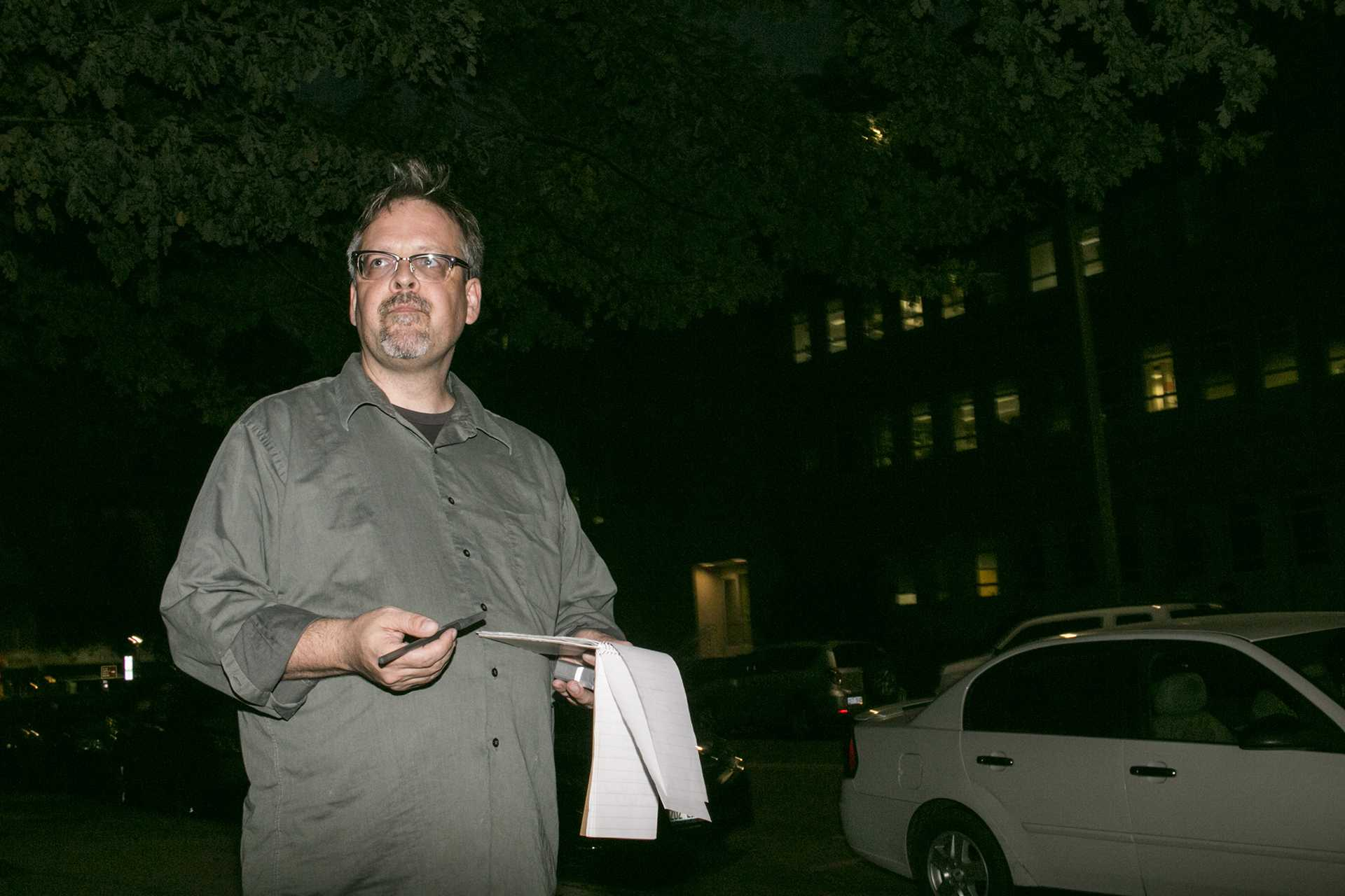 Loren Keller stands outside Van Allen Hall in the spot he stood as a DI reporter in 1991.