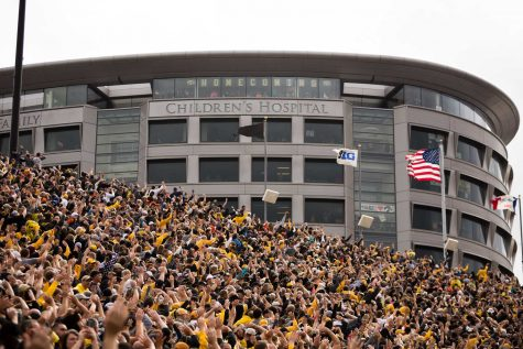 Fans wave to patients in the University of Iowa Stead Family Children's Hospital at the end of the first quarter of the Iowa/Illinois football game on Saturday, 7 Oct. 2017. Iowa won the game 45-16. (David Harmantas/The Daily Iowan)