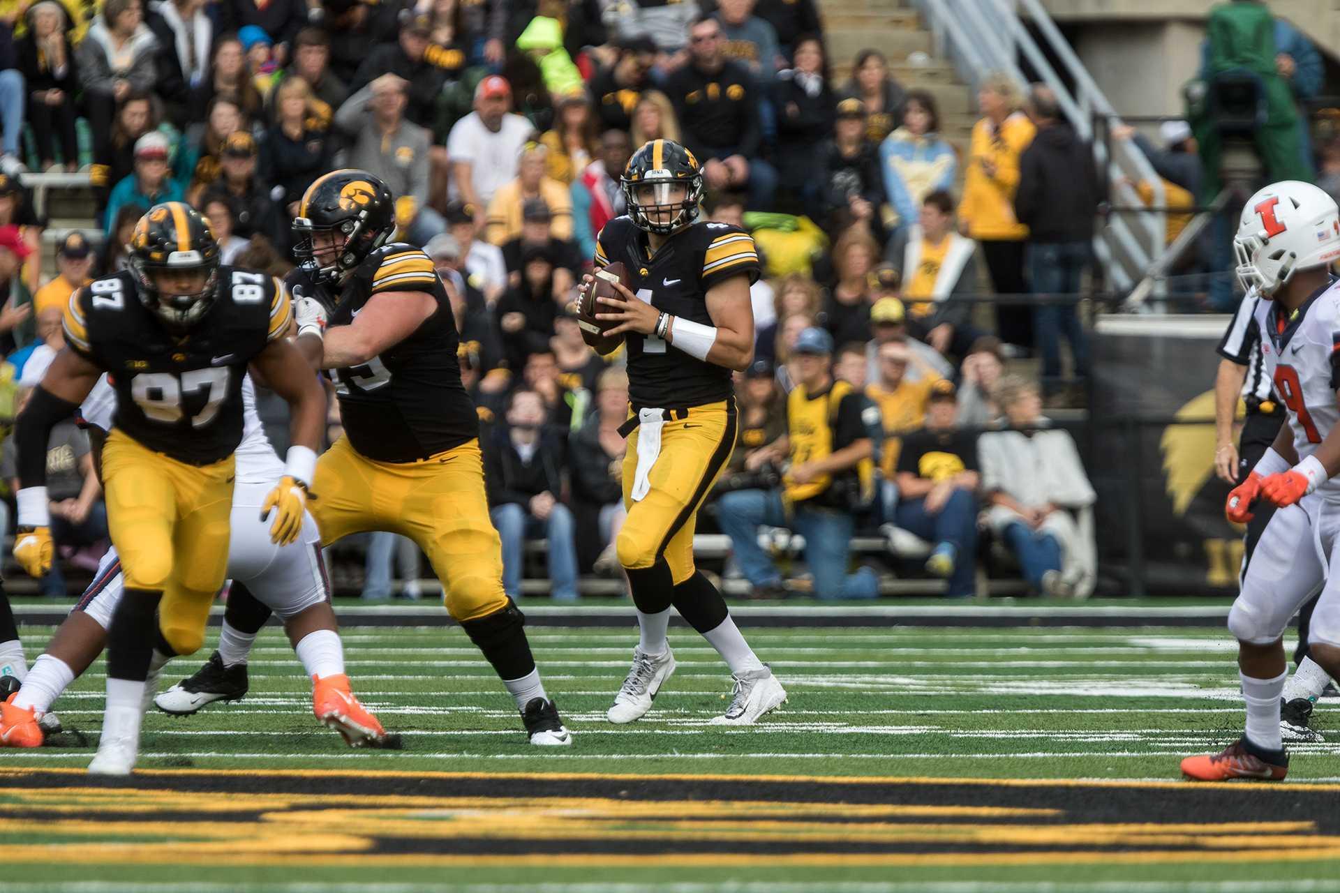 Iowa quarterback Nate Stanley drops back to pass during the Iowa/Illinois football game on Saturday, 7 Oct. 2017. Iowa won the game, 45-16. (David Harmantas/The Daily Iowan)
