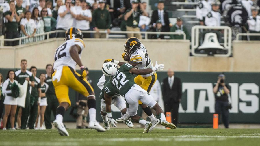 Iowa+running+back+Akrum+Wadley+stiff+arms+a+defender+during+the+game+between+Iowa+and+Michigan+State+at+Spartan+Stadium+on+Saturday+Sept.+30%2C+2017.+The+Spartans+defeated+the+Hawkeyes+17-10.+%28Nick+Rohlman%2FThe+Daily+Iowan%29