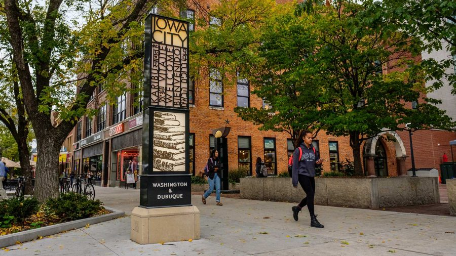 A literature themed sign welcoming visitors to Iowa City is seen on the corner of Washington and Dubuque Streets on Thursday, Oct. 12, 2017.