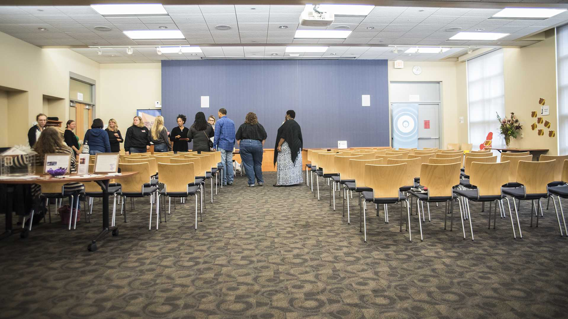People gather in the Iowa City Public Library in October, 2017. (Ben Smith/The Daily Iowan)