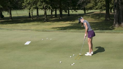 A member of the University of Iowa women's golf team practices her putting on Thursday, Sept. 14, 2017.