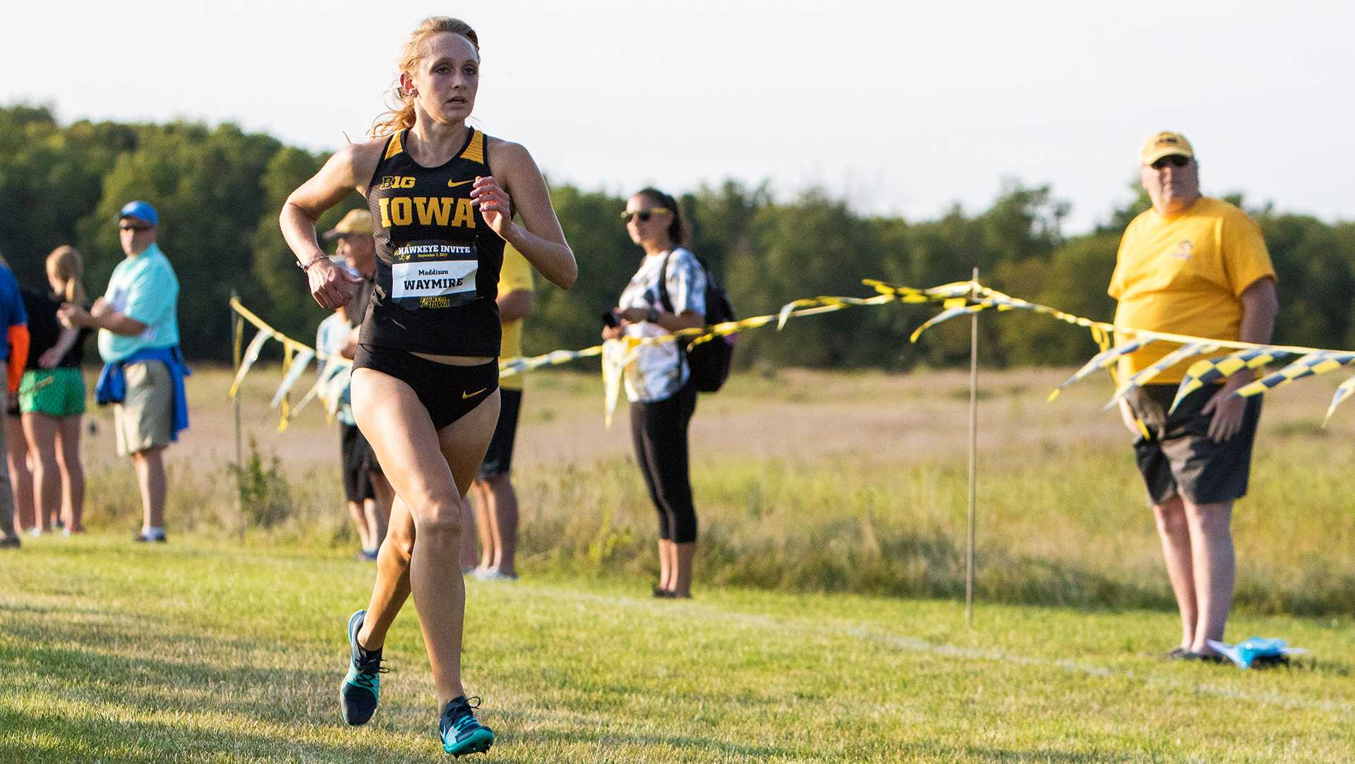 Madison Waymire runs down the chute to the finish line at the Hawkeye Invitational Cross Country meet on Friday, September 1, 2017. (David Harmantas/The Daily Iowan)
