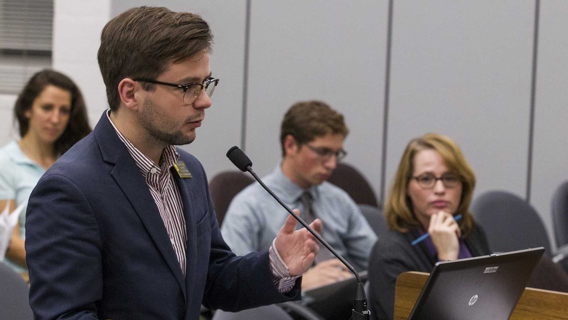 UISG city Council Liaison Benjamin Nelson addresses the city council during a meeting on Tuesday, Oct. 2, 2017. the council unanimously passed a measure making rent abatement easier in situations where landlords violate housing code. (Nick Rohlman/The Daily Iowan)