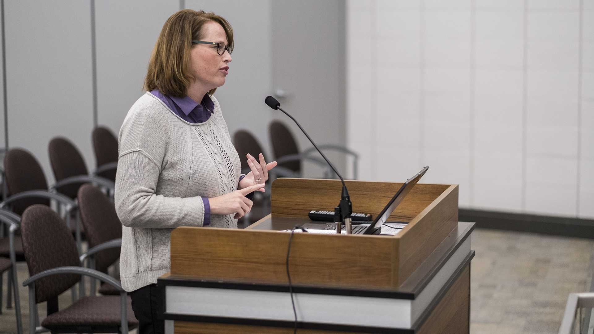 Tracy Hightshoe addresses the council regarding an application for a housing grant during a city council meeting on Tuesday, Oct. 17, 2017. (Nick Rohlman/The Daily Iowan)