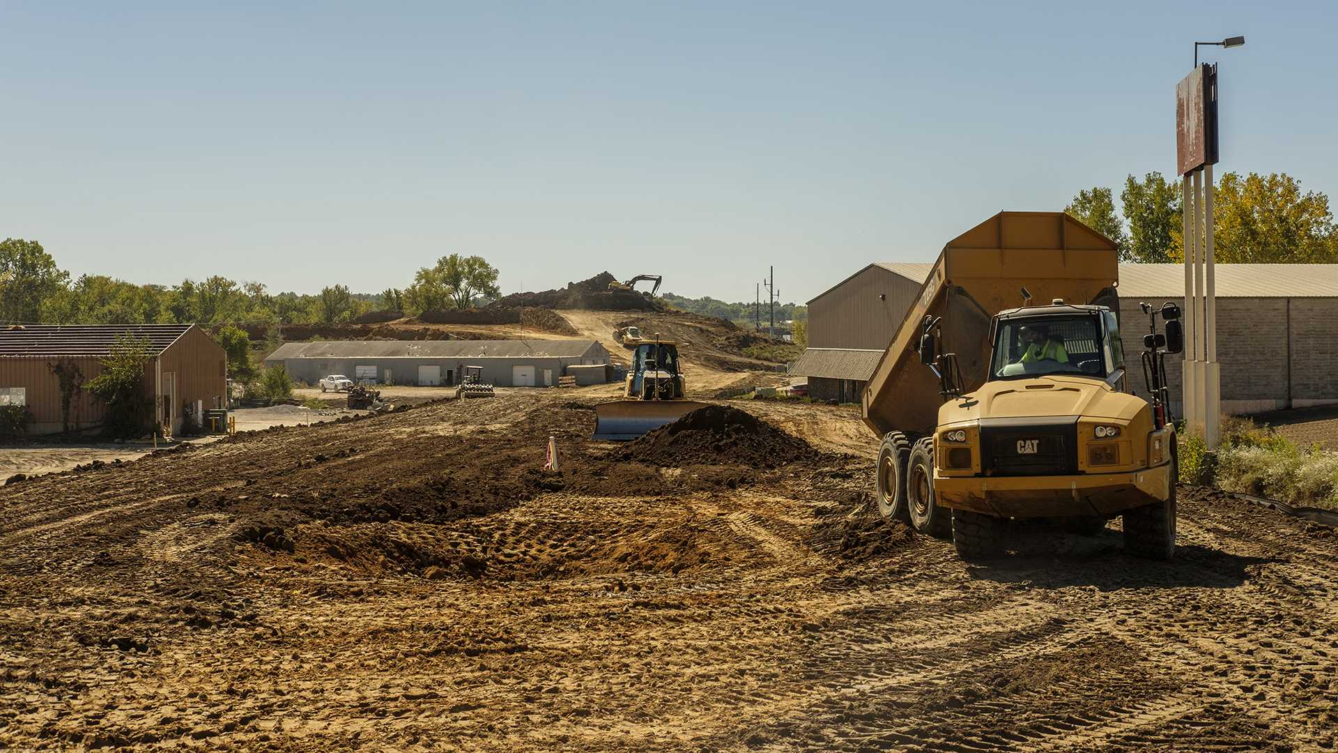 Construction workers begin work at the site of the Planned Iowa River Landing Stadium in Coralville on Thursday, Sept. 28, 2017. The plans for the arena call for a 6,000 seat stadium capable of hosting a variety of events. (Nick Rohlman/The Daily Iowan)
