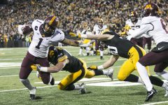 Minnesota running back Rodney Smith gets tackled by Iowa linebacker Josey Jewell and Jake Gervase during an Iowa/Minnesota football game in Kinnick Stadium on Saturday, Oct. 28, 2017. The Hawkeyes defeated the Golden Gophers, 17-10.