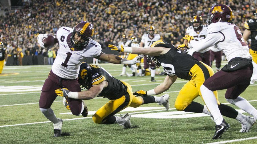 Minnesota+running+back+Rodney+Smith+gets+tackled+by+Iowa+linebacker+Josey+Jewell+and+Jake+Gervase+during+an+Iowa%2FMinnesota+football+game+in+Kinnick+Stadium+on+Saturday%2C+Oct.+28%2C+2017.+The+Hawkeyes+defeated+the+Golden+Gophers%2C+17-10.+