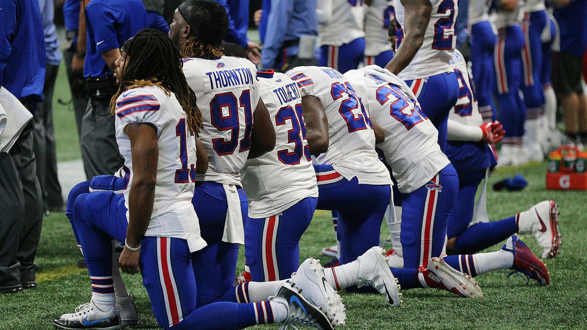 Many of the Buffalo Bill players kneel on the sidelines for the national anthem before the game with the Atlanta Falcons in the land of the free on Oct. 1, 2017 in Atlanta. (Curtis Compton/Atlanta Journal-Constitution/TNS)