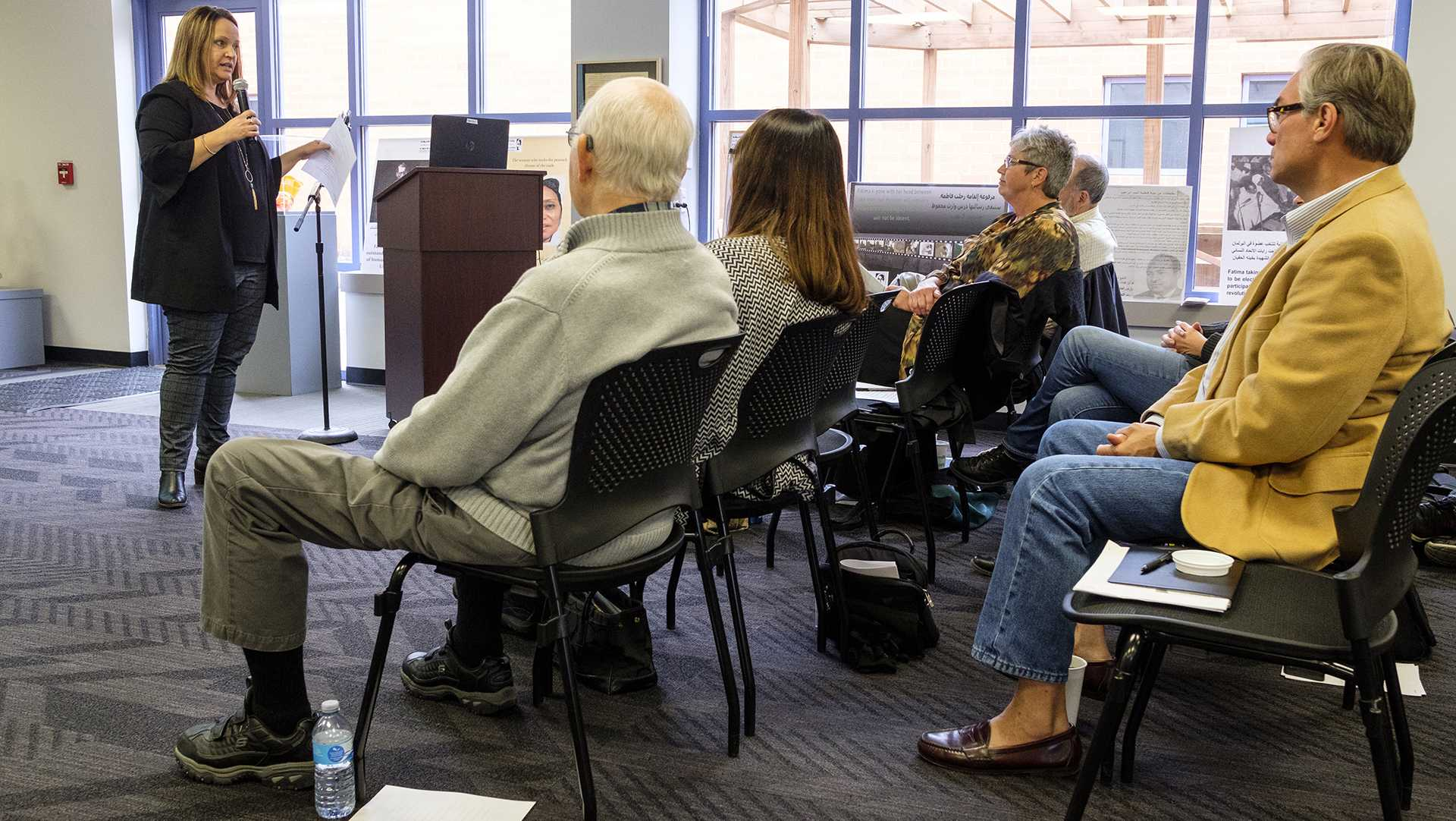 Cathy McGinnis, a probation officer in Iowa's 6th district of correctional services speaks at an event addressing the challenges individuals convicted of crimes face when reentering society on Tuesday, Oct. 24, 2017. McGinnis addressed the challenges of finding employment and housing with a criminal conviction on one's record. (Nick Rohlman/The Daily Iowan)
