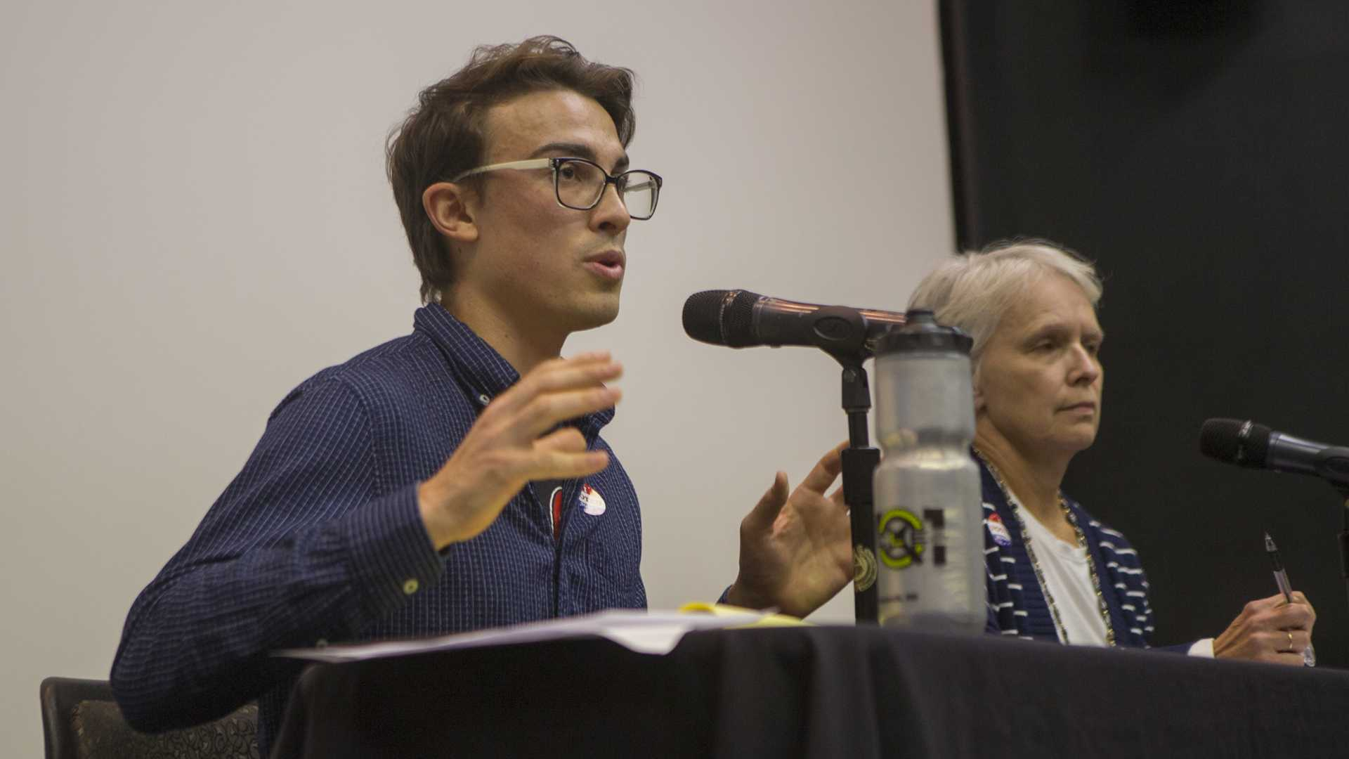 Iowa City City Council District B candidate Ryan Hall speaks during the UISG City Council Forum in the IMU on Wednesday, Oct. 18, 2017. The event gave students and community members the opportunity to ask city council candidates about issues. (Lily Smith/The Daily Iowan)