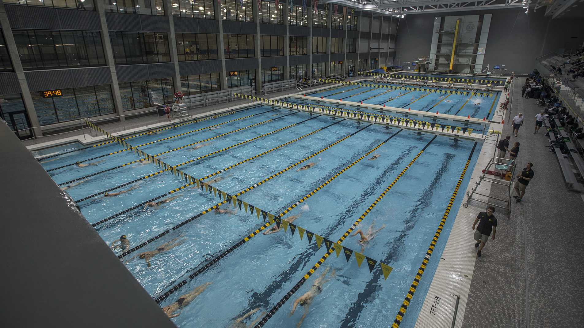 Swimmers warm up before a swim meet between Iowa and Michigan State inside the Campus Recreation and Wellness Center Natatorium on Thursday, September 8, 2017. The Hawkeyes opened their 100th season of swim and dive. (Shivansh Ahuja/The Daily Iowan)