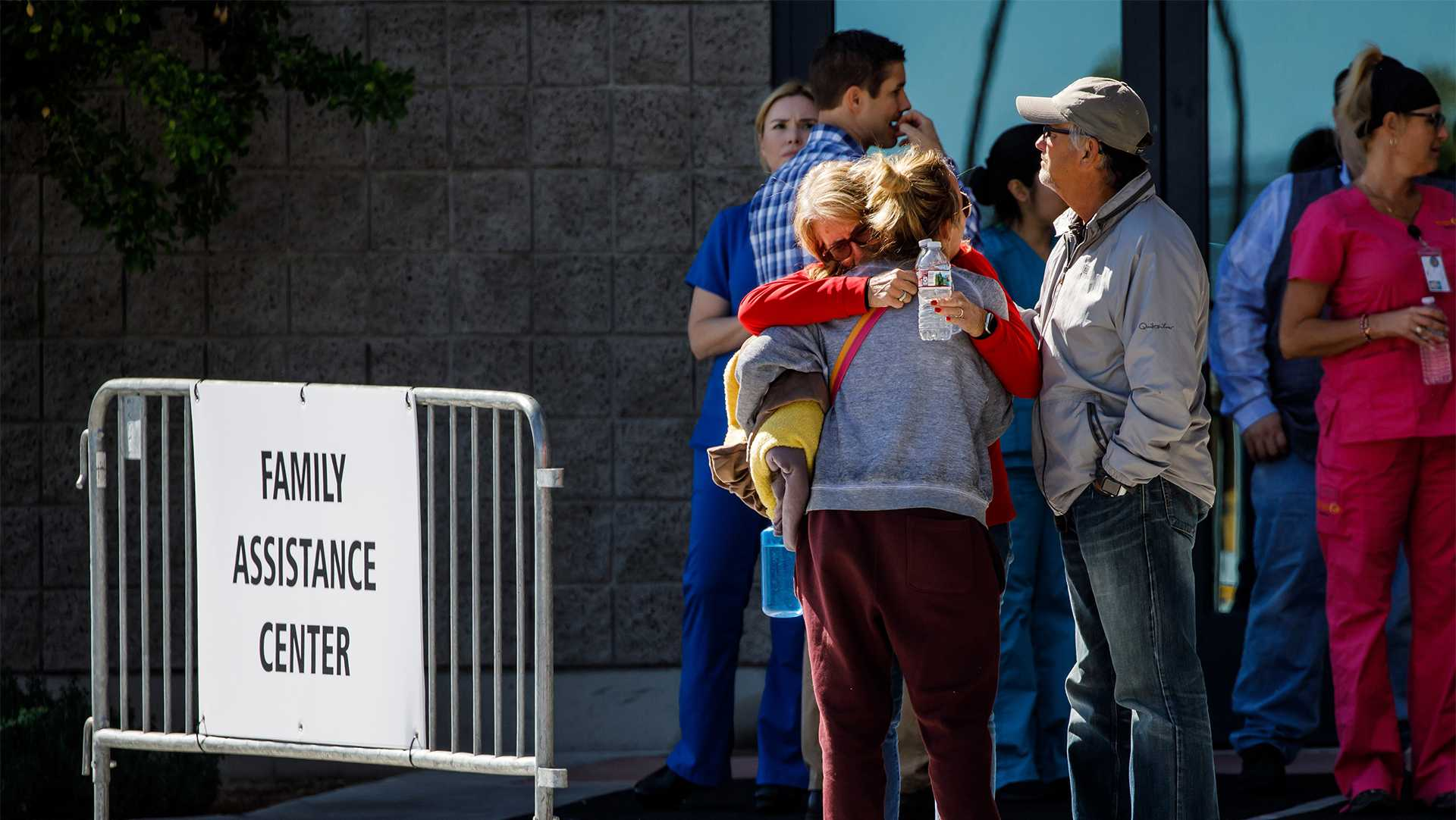 Family members of victims of the recent mass shooting that killed more than 50 and injured more than 500 console each other outside a family assistance center on Oct. 2, 2017 in Las Vegas, Nev. (Marcus Yam/Los Angeles Times/TNS)