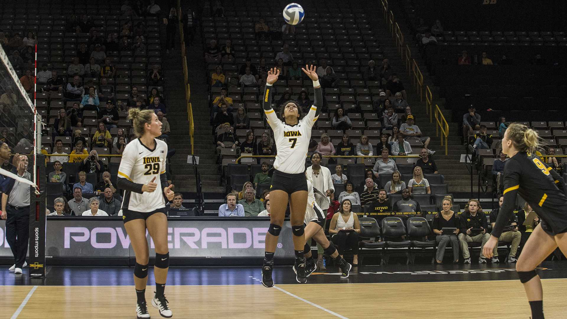 Iowa's Brie Orr sets the ball during a match against Michigan at Carver-Hawkeye Arena on Wednesday, Oct. 4, 2017. Iowa defeated Michigan 3 sets to 1. (Nick Rohlman/The Daily Iowan)