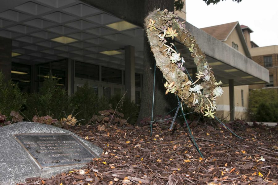 A+memorial+wreath+and+plaque+rest+in+remembrance+of+the+1991+shooting+sit+outside+of+Van+Allen+Hall.