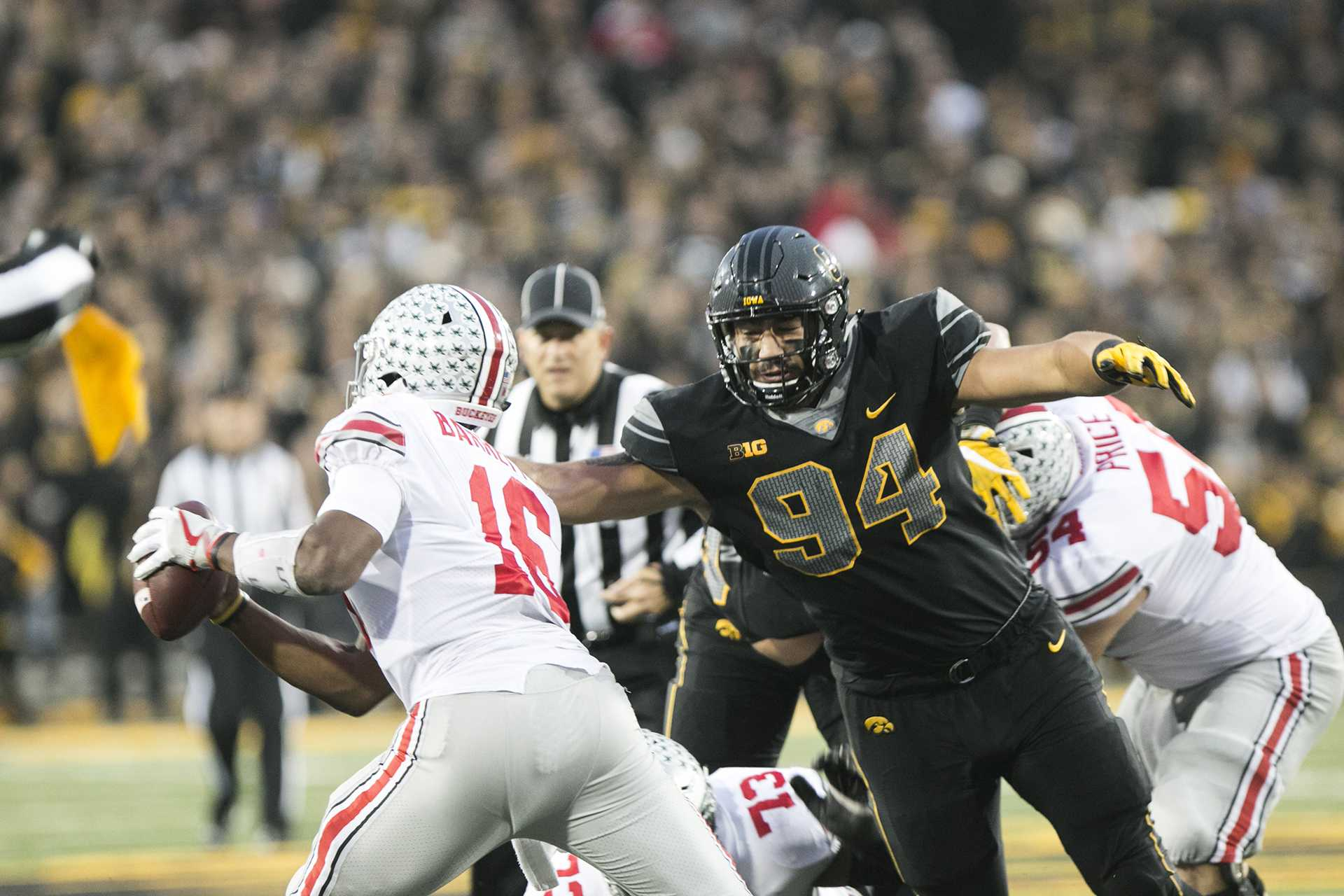 Iowa defensive end A.J. Epenesa goes for a sack against Ohio State quarterback J.T. Barrett during the Iowa/Ohio State football game in Kinnick Stadium on Saturday, Nov. 4, 2017. The Hawkeyes defeated the Buckeyes in a storming fashion, 55-24. (Joseph Cress/The Daily Iowan)